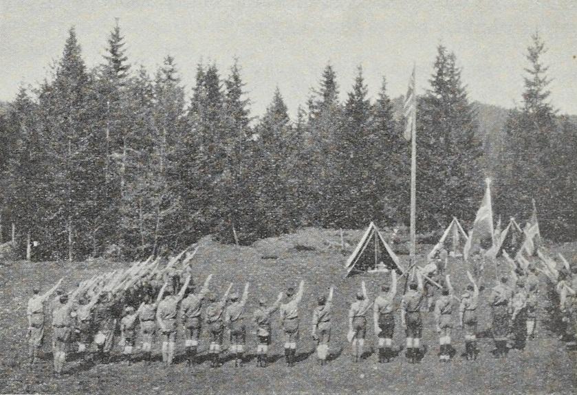 Speidere gjør flagghilsen. Fra 1933-versjonen av Speiderguttboken, s. 188